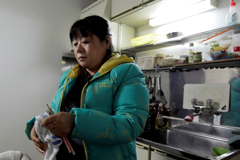 Tang Xili at a shelter for Chinese trainees in Hashima. Photo: Bloomberg/Kiyoshi Ota
