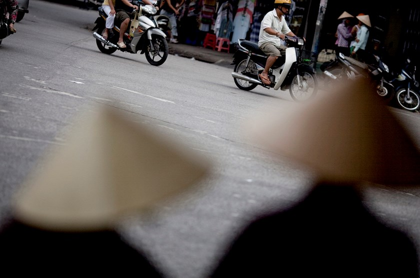 Traffic moves through the Hoan Kiem district of Hanoi. Photo: Bloomberg/Justin Mott
