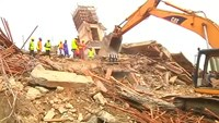 Rescuers dig for survivors after Nigeria building collapse