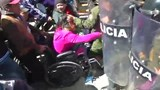 Disabled protesters clash with riot police in Bolivia