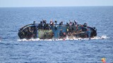 Italian navy says migrant boat flipped, five dead
