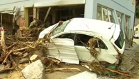 German town awash with mud after floods kill three