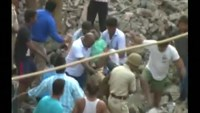 Angry mob says family buried alive in India building demolition