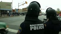 Baltimore pledges police reform after scathing report