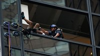 Climber caught after Trump Tower drama
