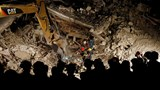Italy rescuers toil through night; death toll hits 159