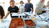 Volunteers prepare special lunch for Italian quake survivors