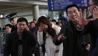 Malaysia Airlines says lost contact with plane carrying 239 people