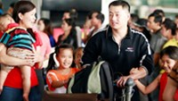 An overseas Vietnamese family at Ho Chi Minh City's Tan Son Nhat Airport