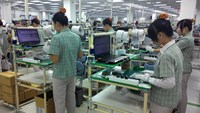 Workers at Samsung's plant in the northern province of Bac Ninh. The South Korean electronics giant plans to build another factory in Ho Chi Minh City. File photo