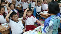 Students learn English at a school in Ho Chi Minh City. Photo: Dao Ngoc Thach