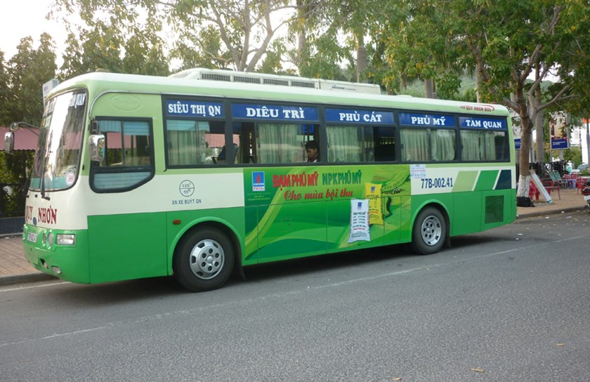 A bus with an ad in Quy Nhon Town in the central province of Binh Dinh. File photo