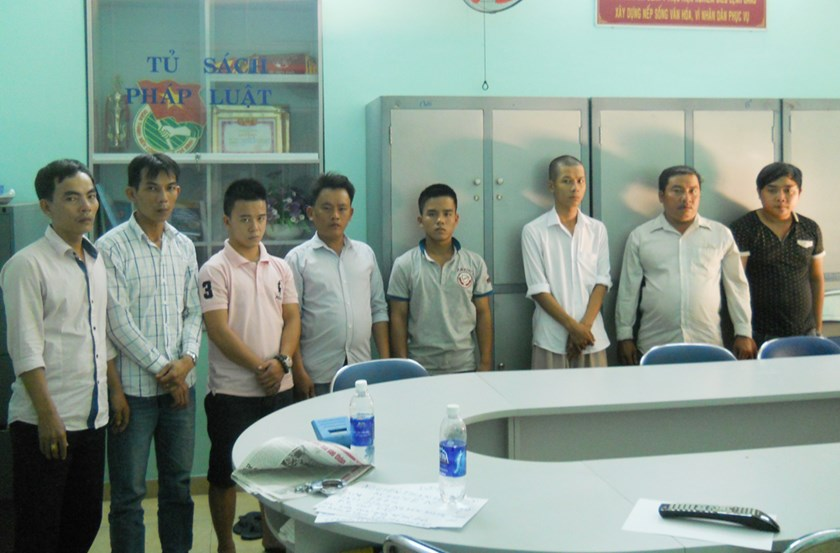 Eight suspects in a certificate forgery ring that was busted in HCMC on January 12. Photo: Dam Huy