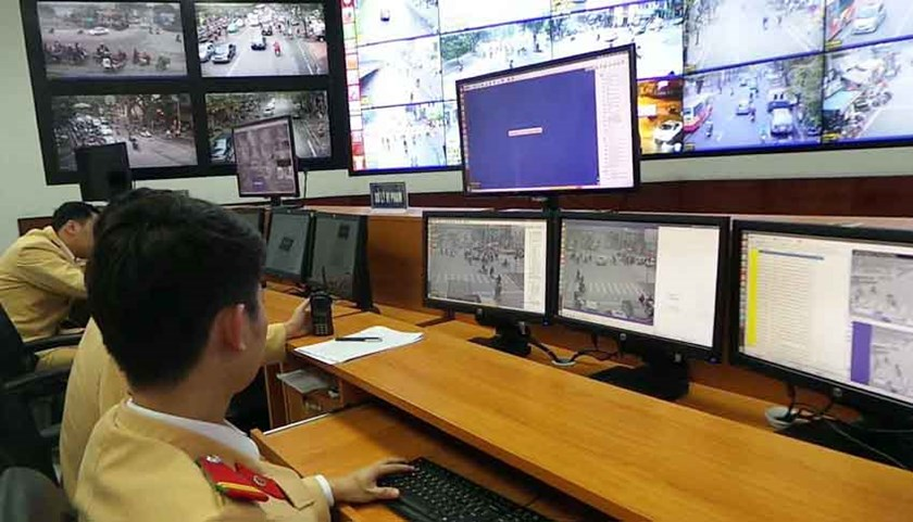 Hanoi traffic police officers supervise images sent in by surveillance cameras established around the city. Photo: Nam Anh