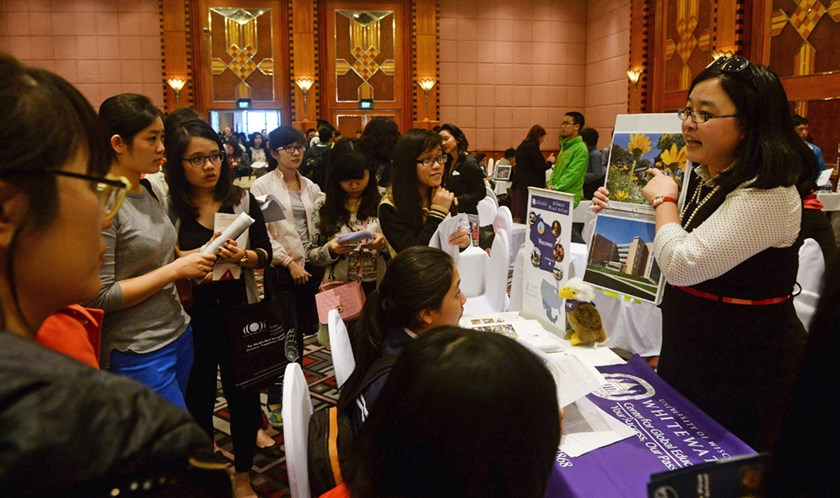 Vietnamese students from local high schools listen to a US college representative during the first US Higher Education Fair in Hanoi on January 30, 2015. Photo: AFP