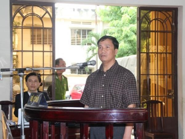"Ngo Van Vinh, a former police officer in the southern province of Dong Nai, stands trial on June 22 for ""murdering"" his boss in September 2013. Photo: Hoang Tuan"