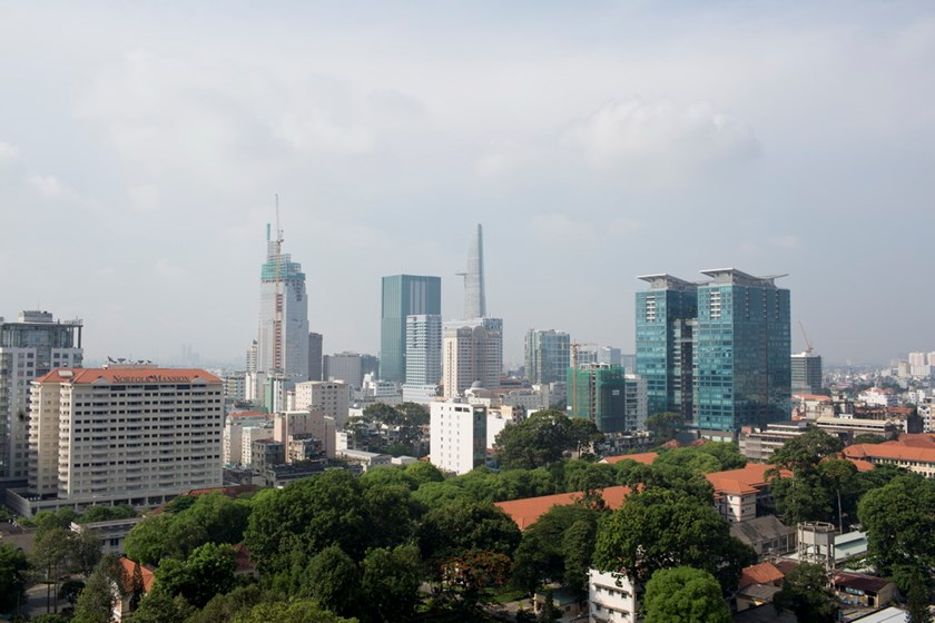 Commercial and residential buildings stand in Ho Chi Minh City. Photo: Bloomberg