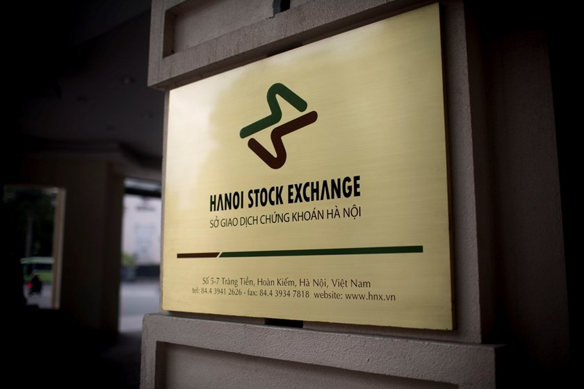 A sign for the Hanoi Stock Exchange is displayed on the stock exchange building in Hanoi. Photo: Bloomberg