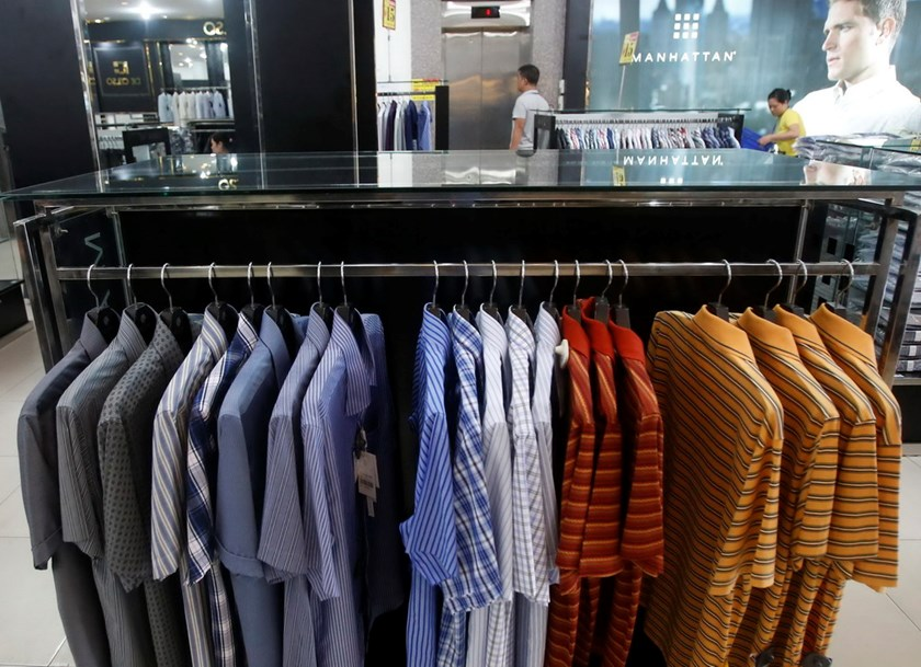 Shirts are displayed for sale inside a Vinatex supermarket in Hanoi. Vietnam's top textiles and garment maker, Vinatex, had its IPO last year. Photo: Reuters