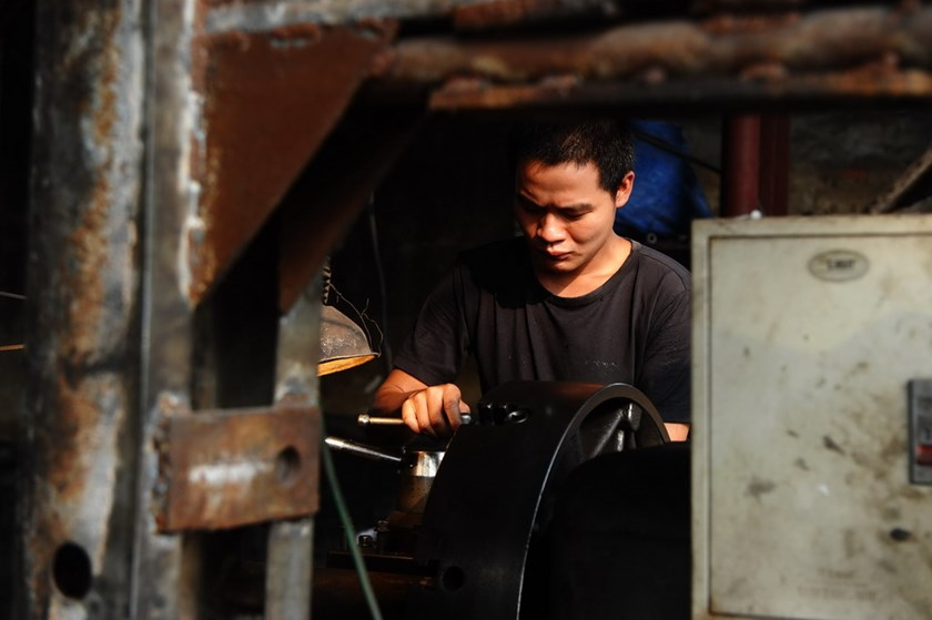 An employee at a private mechanic workshop on the outskirts of Hanoi. Photo: AFP