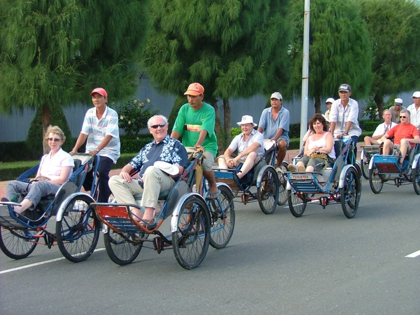A file photo of foreign tourists on a cyclo tour in Vietnam