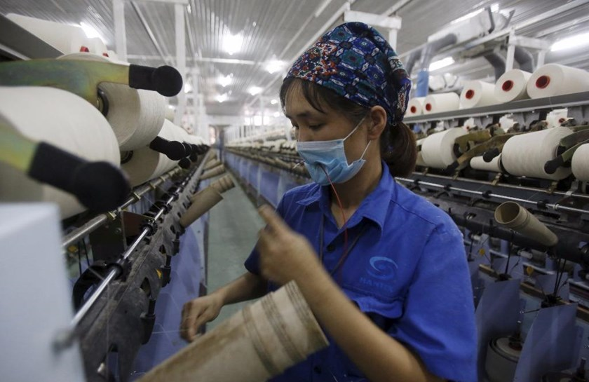 An employee works at a yarn weaving plant in Ha Nam province, outside Hanoi. Photo: Reuters