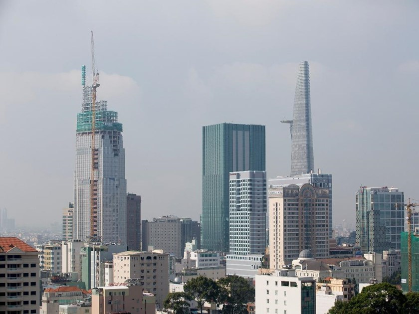 Commercial and residential buildings stand in Ho Chi Minh City. Thailand's biggest consumer products distributor Saha Group says it is interested in expanding property business in Vietnam in the long term. Photo: Bloomberf