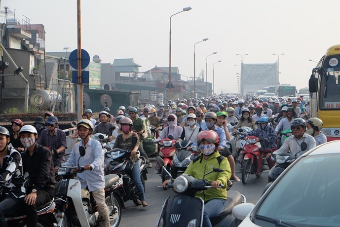 Vehicles crowd a street in Hanoi. Photo: Ha An