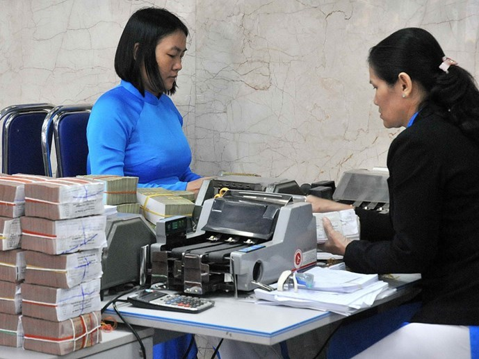 A file photo of a bank in Hanoi. Banking is among five sectors which state-owned enterprises have been ordered to divest from. Photo: Hong Suong