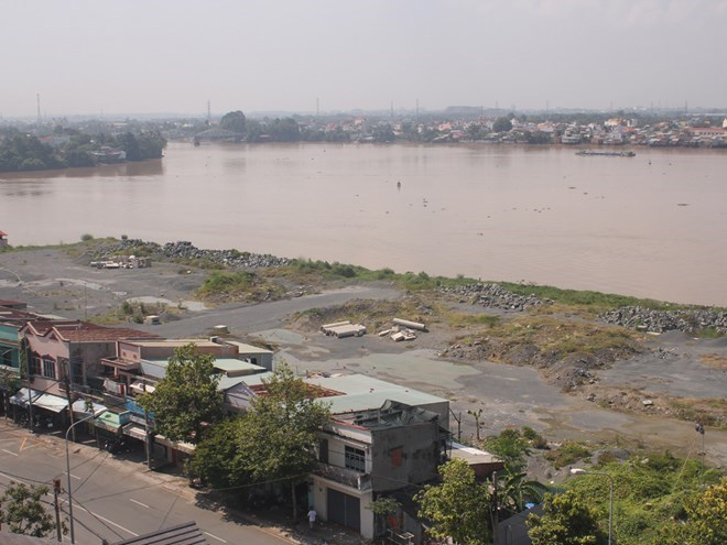 The suspended construction site of a housing and shopping mall complex on the Dong Nai River's side