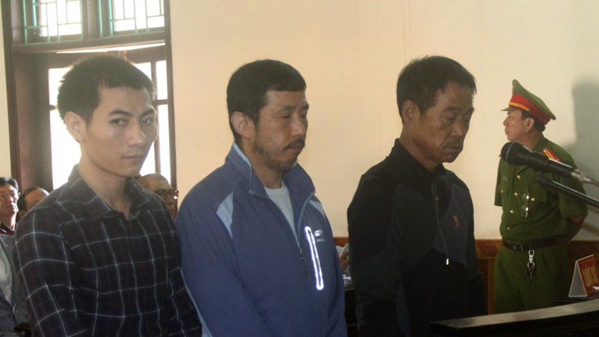 Three people, including two South Koreans, stand trial in the central province of Ha Tinh on November 16. The hearing was later suspended. Photos: Nguyen Dung