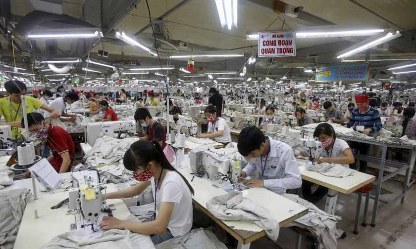 Workers at a garment factory in Bac Giang Province, near Hanoi. Photo: Reuters