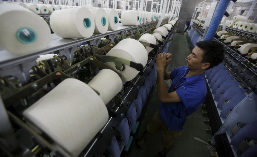 A man works at a yarn weaving plant in Ha Nam Province outside Hanoi. Photo: Reuters
