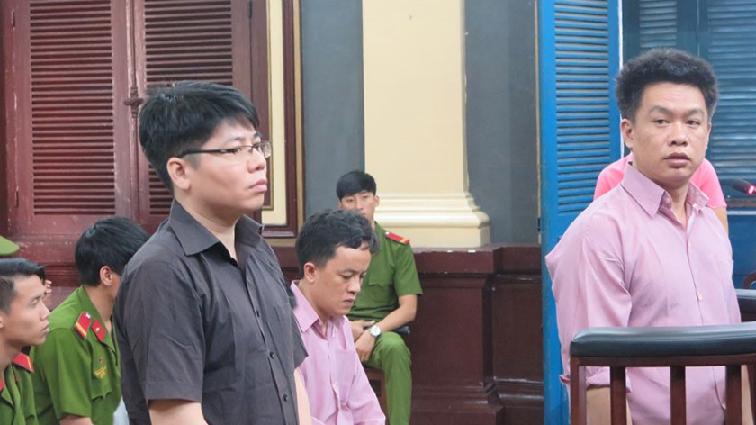 Nguyen Giang Lam (L), 40, and Nguyen Quang Vinh, 33, at a Ho Chi Minh City court on December 31. They and another two were convicted of smuggling $5.3 million worth of luxury cars in 2011-12. Photo: Phan Thuong