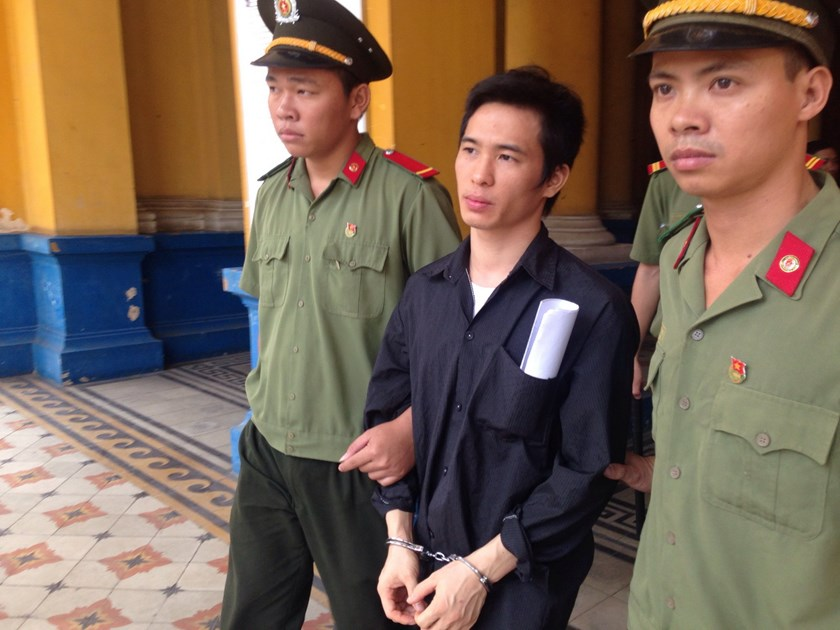 Hoang Hai Trai, 28, is escorted to prison after a trial in Ho Chi Minh City on March 23, 2016. He is jailed for one year for making bomb hoaxes. Photo: Ngoc Le
