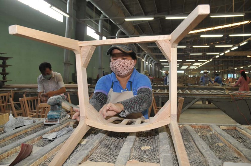 An undated photo of a worker working at a wood factory in Ho Chi Minh City. Photo: Diep Duc Minh/Thanh Nien