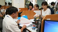 A file photo of people submitting taxes at Ho Chi Minh City's tax department. Photo: Kha Hoa