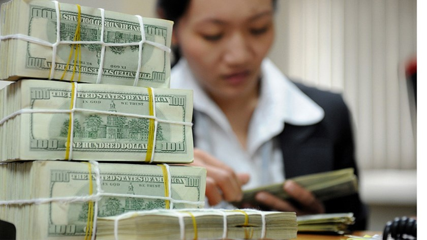 An undated photo of stacks of US dollar notes at a bank in Hanoi. Photo: Anh Vu/Thanh Nien