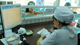 A file photo of a patient registering for a check-up at a hospital in Ho Chi Minh City. Photo: Nguyen Mi