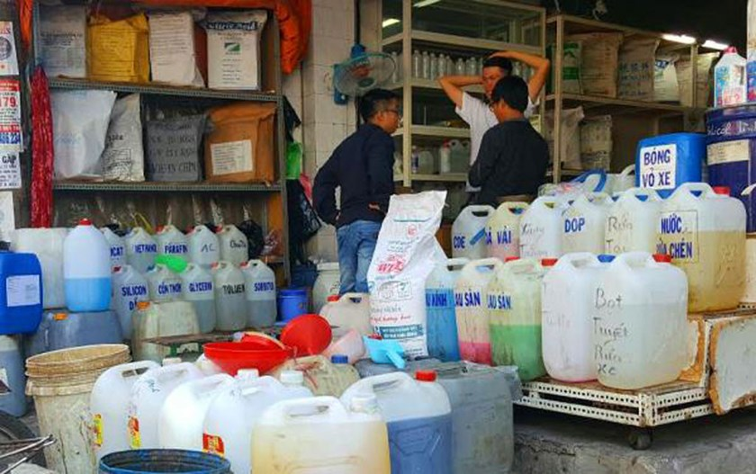 Containers of chemical substances displayed at a store at Kim Bien Market, Ho Chi Minh City. Photo: Doc Lap
