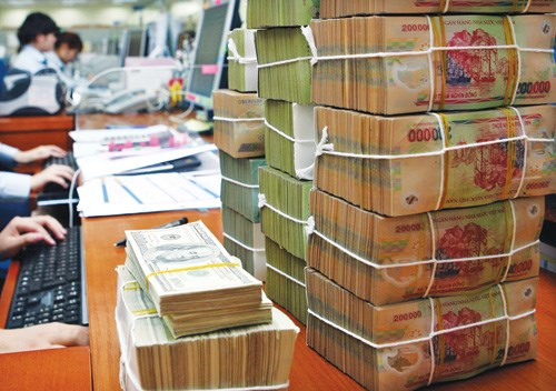 Threat to local banks could come from ASEAN rivals, which are strong in the field of banking retail, a new survey has found. They may infiltrate into the domestic market after the AEC establishment, it says. Photo: Ngoc Thang