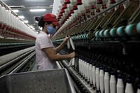 A laborer works at a yarn weaving plant of the Ha Nam textile company in the namesake province's Phu Ly town, about 60 kilometers south of Hanoi. The majority of respondents hold a positive outlook on the future and say that the future FTA will bring a po