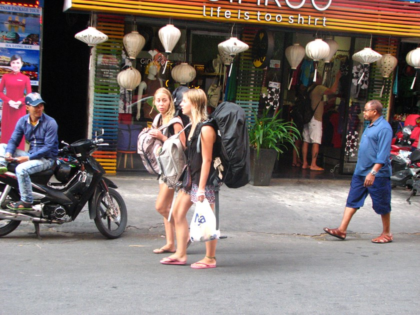 Foreign tourists walk in the backpackers' area in Ho Chi Minh City. Photo: Thao Vi