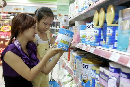 A woman selecting milk at a supermarket in downtown Ho Chi Minh City. Photo: Dao Ngoc Thach