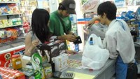 Customers pay at a Shop&Go convenience store in Ho Chi Minh City. File photo