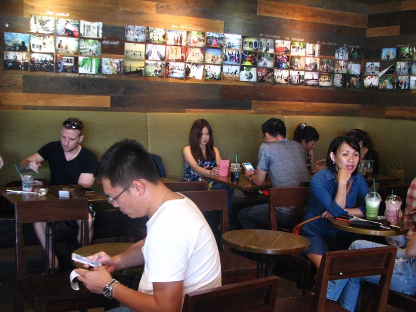Customers at a Starbucks cafe in downtown Ho Chi Minh City. Photo: Thao Vi