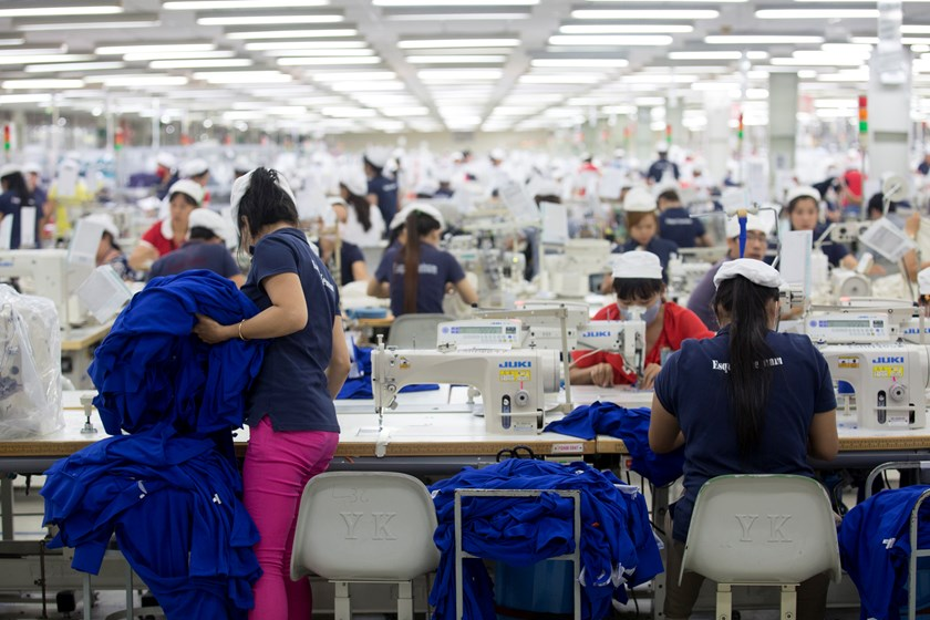 Workers sew clothing at the Esquel Group garment factory at the Vietnam-Singapore Industrial Park. Photo: Bloomberg