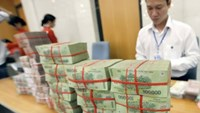 An undated photo of stacks of money arranged inside a bank in Hanoi. Photo: Ngoc Thang