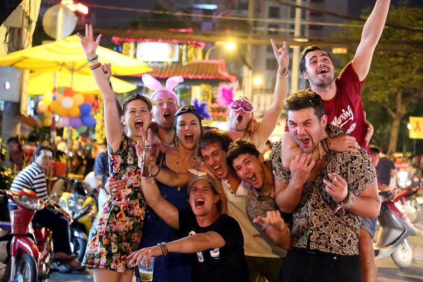 Foreigners pose for a photo during an event in Ho Chi Minh City. Photo: Dao Ngoc Thach