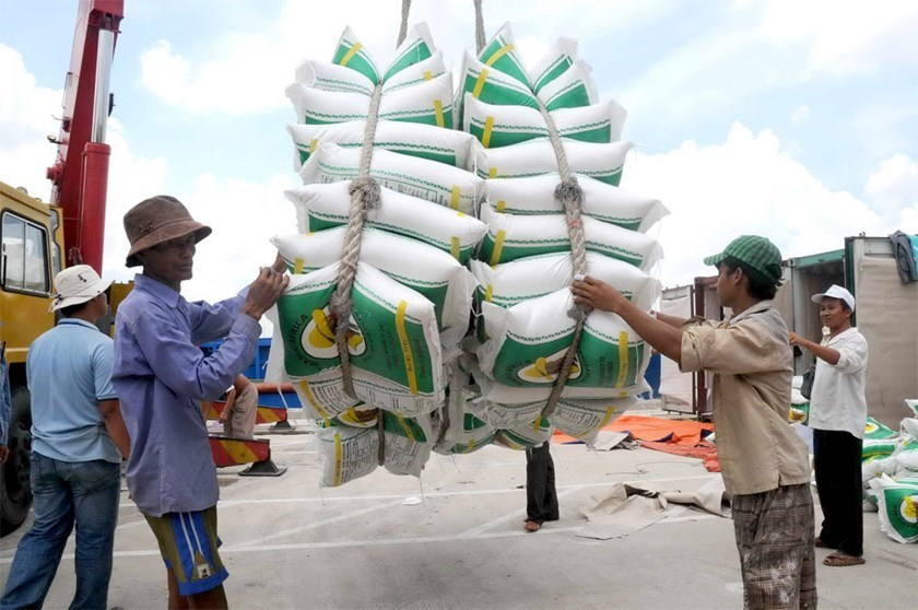 Workers load rice sacks at a seaport in Ho Chi Minh City. Photo: Diep Duc Minh